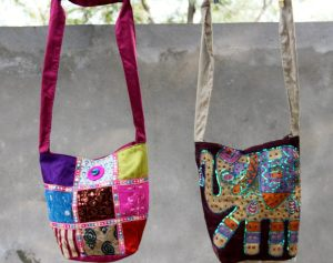 a.ku designs two bags