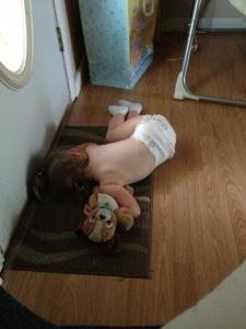 sleeping in front of front door