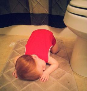 sleeping in front of the toilet