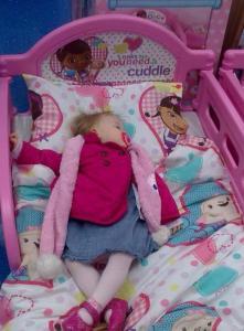 sleeping in toy shop display bed