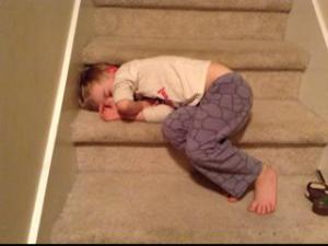 sleeping on the stairs waiting to go to bed