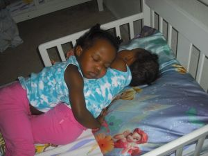 sleeping twins cuddle