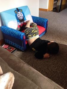 sleeping upside down on chair and floor