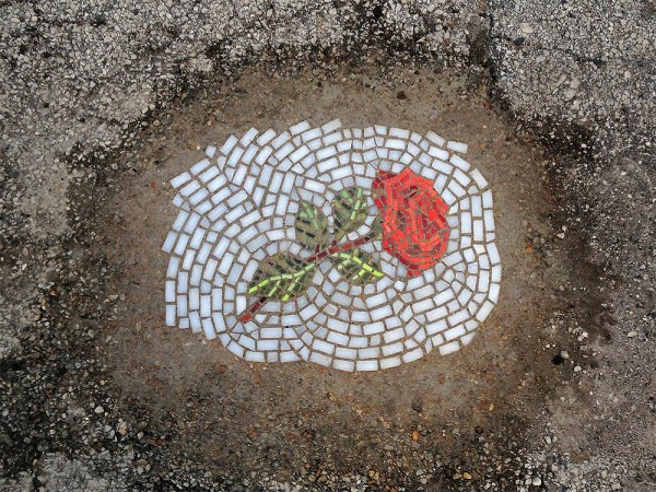 artist creates mosaics in potholes2