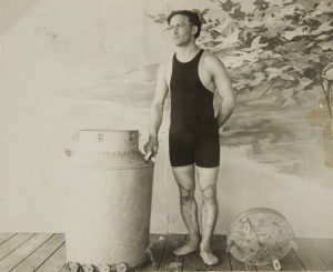Harry Houdini with a milk can