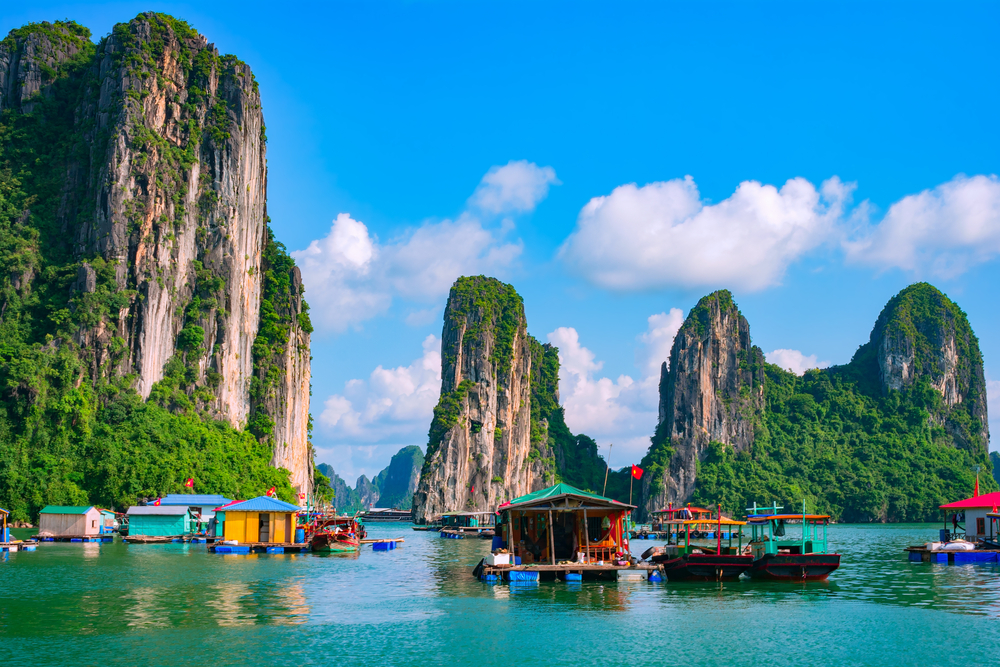 Floating fishing village and rock island in Halong Bay, Vietnam