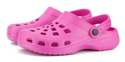 a pair of pink crocs