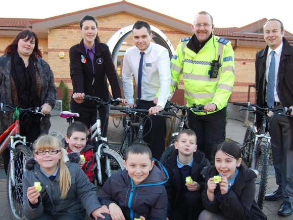 Moorland Assistant Neighbourhood Assistant Rachel Taylor, Lincolnshire Co-op Moorland Avenue Foodstore Duty Manager Sarah Rogers, Lincolnshire Co-op Moorland Avenue Foodstore Manager Danny Austin,  PCSO David Freeman and Moorland County Councillor Kelly Smith. Front row: Abby Wilkins (9), Ryan Hope (8), Lukas Filipivicuius (8), Josh Clarricoates (9) and Courtney Challis-Reeve (8) from The Priory Witham Academy.