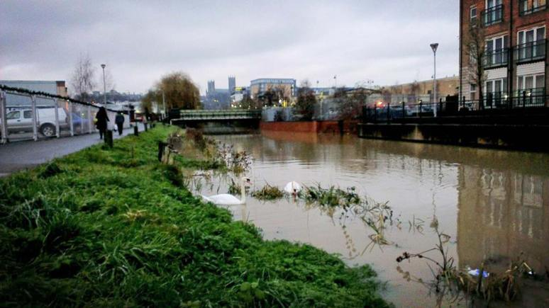 Slight overflow due to rising water levels in River Witham in Lincoln on Friday morning. Photo: Joel Murray
