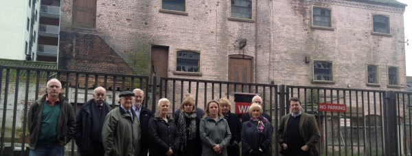 Nearby residents met at Wigford Yard with Carholme ward Councillor Neil Murray (far right) on January 7 to voice their concerns over the plans for the area.