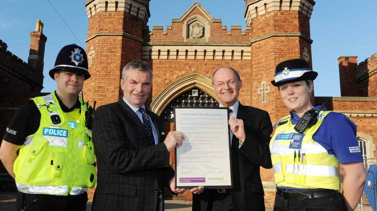 Lincolnshire County Council Leader Martin Hill (centre, left) and Police and Crime Commissioner Alan Hardwick (centre, right) with their cooperation pledge, outside Lincoln Prison, alongside PC Jason Smeaton (far left) and PCSO Stephanie Clare (far right).
