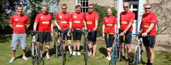 Lycra for charity (L-R): Simon Sewell, Simon Gregory, Tim Clark, Andrew Buckley, Rob Key, Hayley Townsend, Tim Wright and Julian Anyan