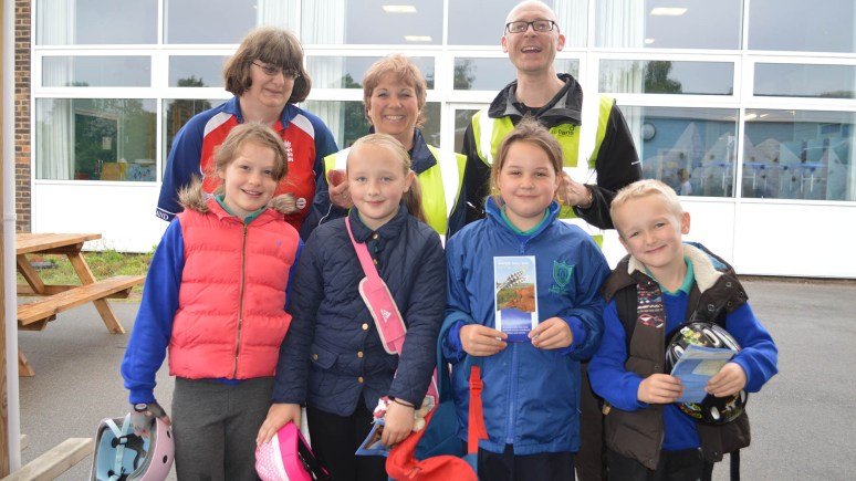 Mrs Helen Hinson (Teaching Assistant), Mrs Julie Parkinson (Teaching Assistant) and Vincent Gibson (Sustrans) with children at the Bike Breakfast at Ling Moor Primary School