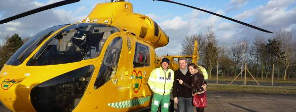 Charlotte and her partner Tony with the Lincolnshire and Nottinghamshire Air Ambulance ambucopter.