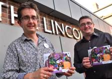 Creative Director Simon Hollingworth and Chief executive Chris Kirkwood with Lincoln Drill Hall's Autumn 2013 brochure. Photo: Steve Smailes for The Lincolnite