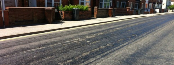 Burton Road in May 2012, where attempts at resurfacing caused melting in the heat. Photo: Trevor Gibbs