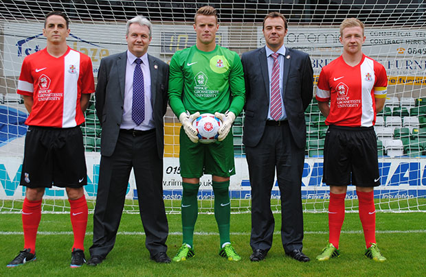 The new Imps kit (L-R): Jake Sheridan, Rev Prof Peter Neil, Vice Chancellor of BGU, Paul Farman, Rob Jones, Director of Enterprise at BGU, Alan Power