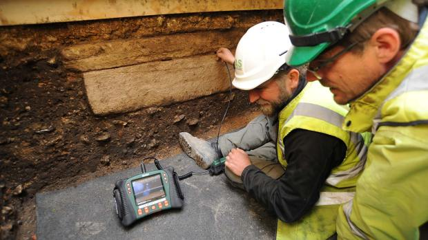 Archaeologists are looking inside the coffin (seen from the side) using remote cameras. Photo: Lincolnshire County Council