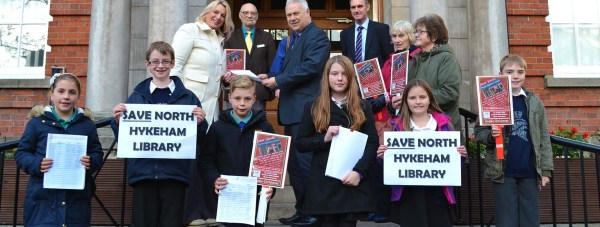 School children from Fosse Way, South Hykeham and Ling Moore primary schools met alongside library users, to hand over a 762-strong petition to save North Hykeham Library. Organiser Kay Gibson hand the signatures over to Niel West, democratic Service Manager. Photo: The Lincolnite