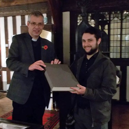 The Chancellor presents the facsimile to James Wakefield. Photo: University of Lincoln