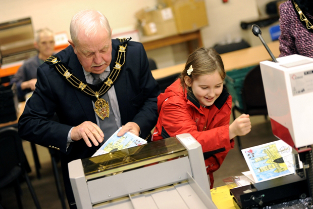 Sarah Robinson, aged 8, joined the Mayor at the Pelican Trust's printing facility. Photo: Stuart Wilde