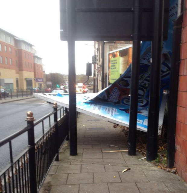 An advertising board was damaged by the wind and blocked the pavement on Broadgate.