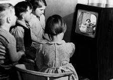 Children watching BBC show Andy Pandy on a BW TV set. Photo: TV Licensing