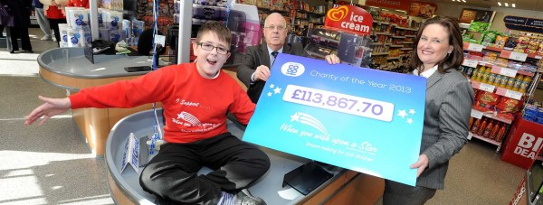 Callum Smith, 11, Lincolnshire Co-op President Malcolm Hoskins and When You Wish Upon A Star's Regional Fundraising Manager Joanne Heywood. Photo: Lincolnshire Co-op