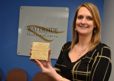 Chantelle Henderson with the Roman store card, found under the Waterside. Photo: Steve Smailes for The Lincolnite