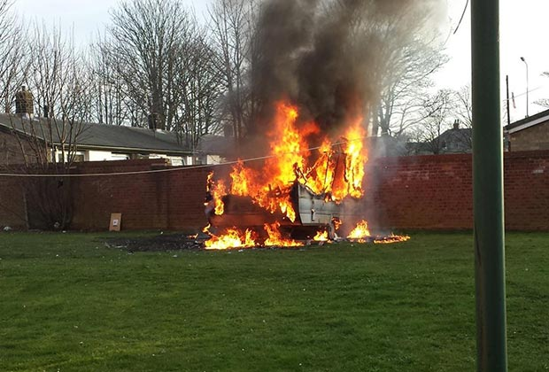 The caravan on fire in the green space on Browning Drive in Lincoln. Photo: Nigel Mulhall