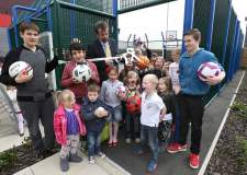 Howard Westoby (back), housing officer, with local children for the opening of the games area.