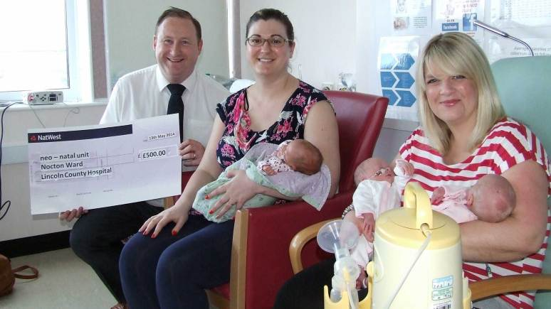 Michael Hollamby, Director of pip Property Group, giving the cheque for £500 to the neonatal unit in Lincoln.