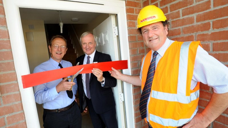 Council Leader Ric Metcalfe, Chief Executive Andrew Taylor, Director of Housing and Community Services John Bibby and Chairman of Lindum Group, David Chambers, celebrate the completion of five new council homes in Stapleford Avenue. Photo: Stuart Wilde