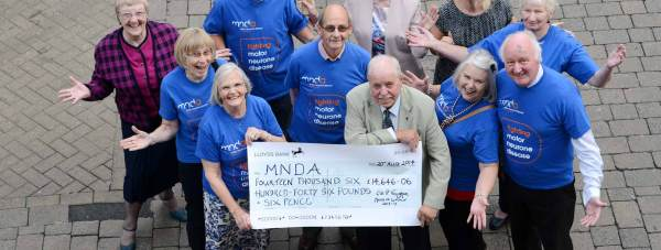 Councillor Patrick Vaughan and the cheque for the Motor Neurone Disease Association. Photo: CoLC