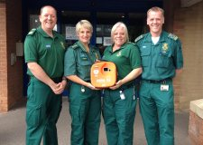 EMAS community resuscitation trainers Steve Pratten, Many Lowe, Mary Spier and Bruce Fraser with an Asda defibrillator.