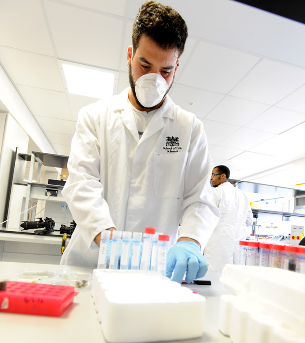 A PhD student works on DNA extraction in the Molecular Biology Lab. Photo: UoL