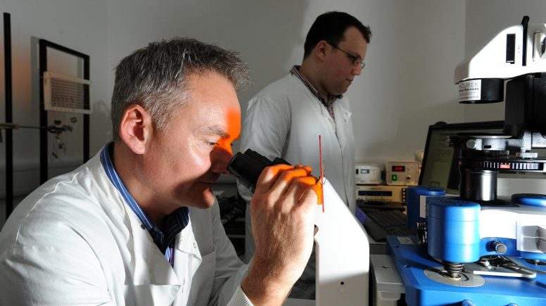 Professor Paul Squires from the School of Life Sciences at the University of Lincoln and PhD student Gareth Price using an atomic force microscope. Photo: UoL