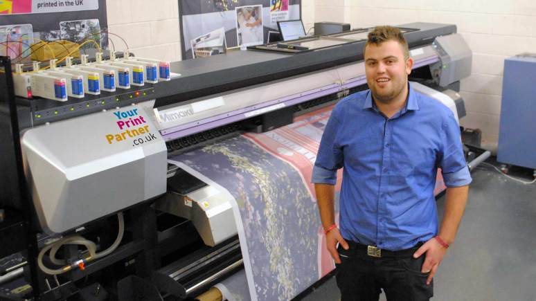 Stuart Maclaren, Director at Your Print Partner with the new machinery.