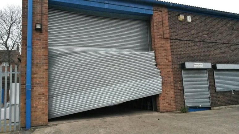 The van was driven through the metal shutters, causing hundreds of pounds' worth of damage.