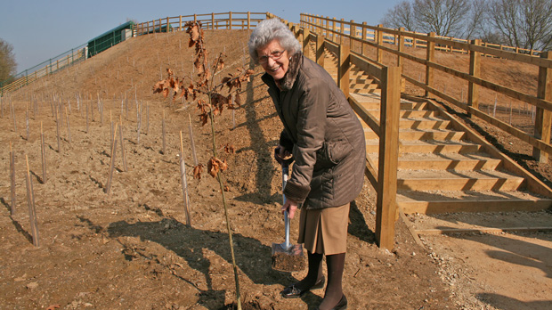 Cllr Mrs Marion Brighton planted oak trees around the area of the new bridge to celebrate the opening. Photo NKDC