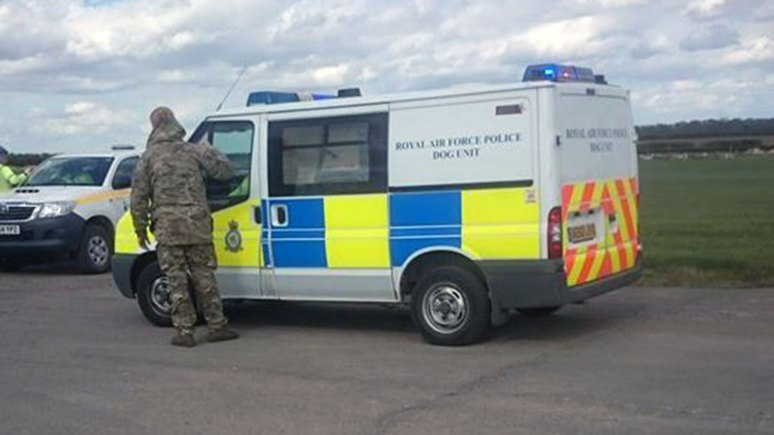 The Royal Air Force Police Dog Unit is on scene on the runway at RAF Waddington.
