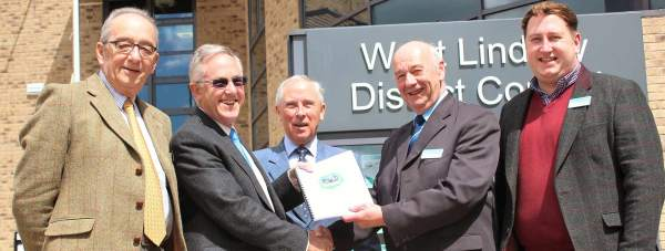 Left to right, Joseph Siddall, vice chair of the Nettleham Neighbourhood Plan Steering Committee, John Evans, chair of the Nettleham Neighbourhood Plan Steering Committee, Chair of Nettleham Parish Council Terry Williams and West Lindsey District Councillors, Steve England and Giles McNeill at the Guildhall, Gainsborough