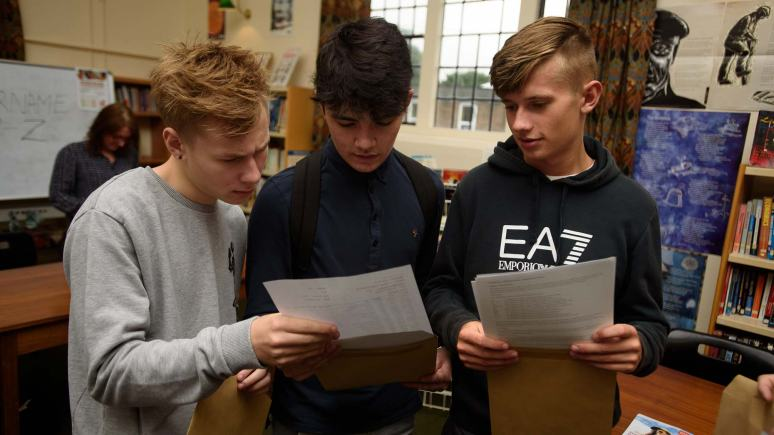 Joe Bisby, George Morgan Scott Woolley opening their results and Lincoln Christ's Hospital School. Photo: Steve Smailes for The Lincolnite