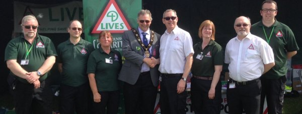 Mayor of Lincoln, Councillor Andrew Kerry with the LIVES team at the 2015 Lincolnshire Show