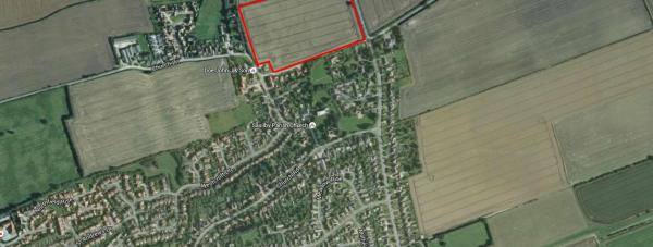 The site of the proposed new homes and cemetery extension. Photo: Google Earth
