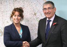 Peter Aldrick welcoming Karen Jobling at the charity's operational base at RAF Waddington