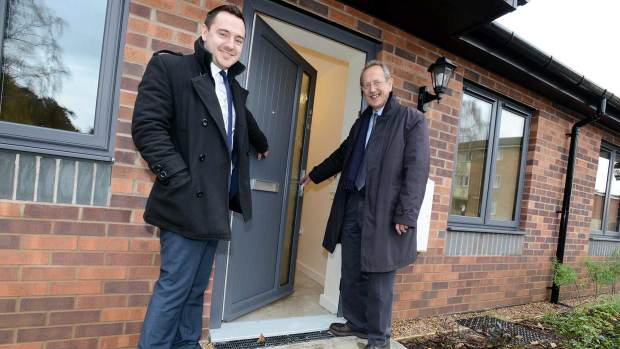 Michael Broadhurst, Project Co-ordinator for Woodhead Living, and Councillor Ric Metcalfe, Leader of the city council, celebrate the completion of the new bungalows