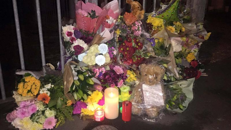 Tributes left at the scene of the fire, outside the house on De Wint Avenue in Lincoln.
