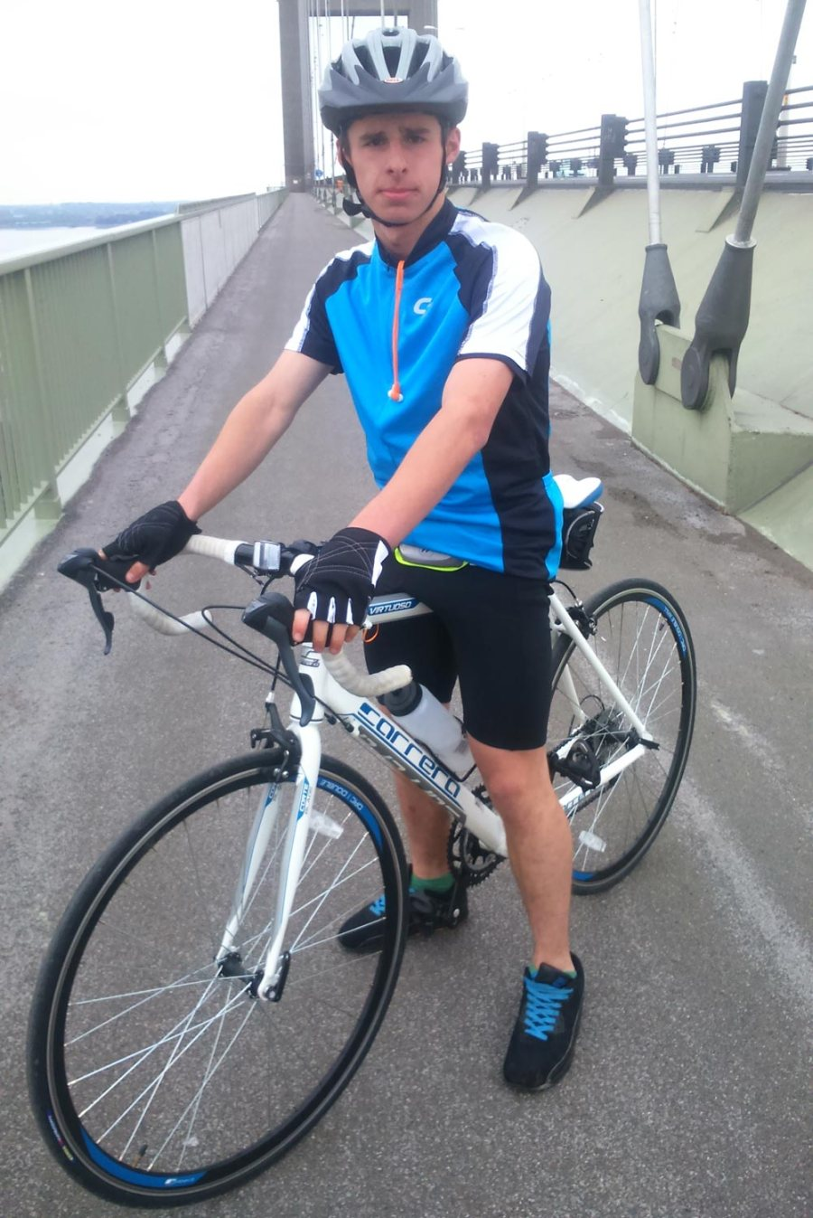 Baily Speed at the Humber Bridge on his bike ride for Cancer Research