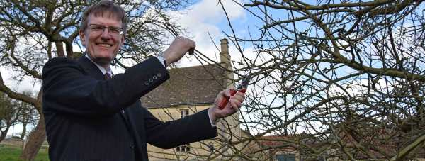 A-cutting-of-the-Isaac-Newton-tree-is-taken-by-Pro-Vice-Chancellor-Professor-Andrew-Hunter-from-the-University-of-Lincoln